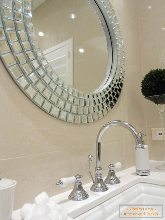 Stylish mirror over the sink in the bathroom