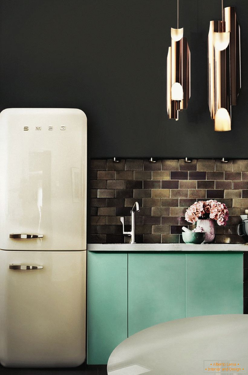A small kitchen in dark colors and a vintage fridge