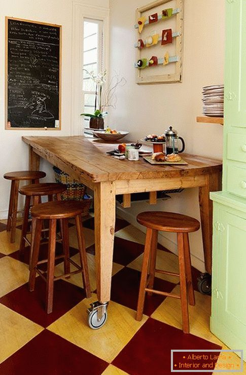 Wooden dining table on wheels