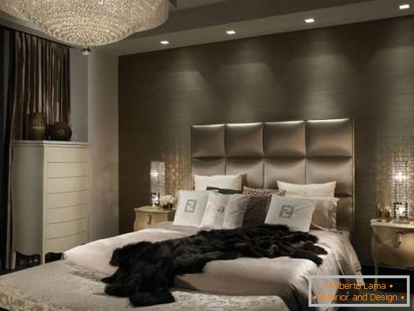 Classic chandelier and built-in lamps in the bedroom design