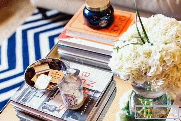 Books on a coffee table with a different decor