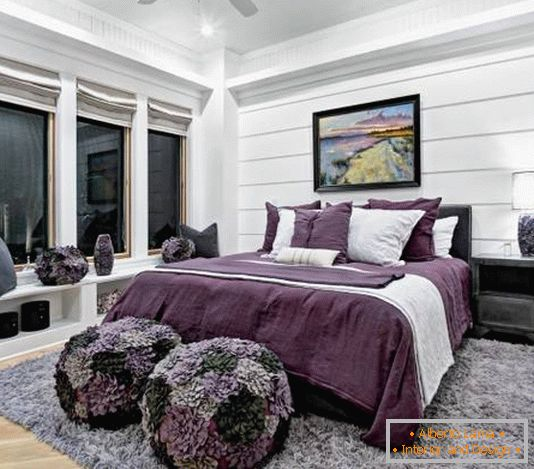 Black and white bedroom with violet accents