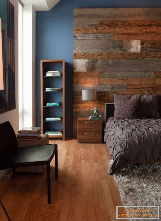 Large wooden headboard and stylish furniture in the bedroom