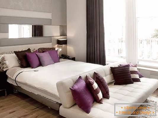 Stylish furniture in the bedroom with purple accents