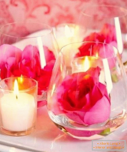 Flowers and candles as a table decoration for Valentine's Day