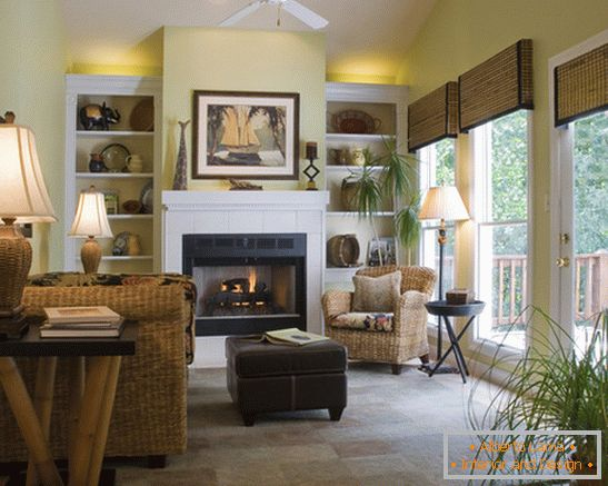 Wicker furniture in the living room with fireplace