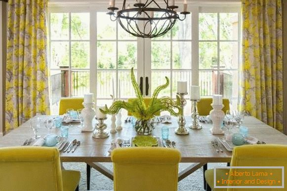 Yellow curtains in the interior of the dining room kitchen