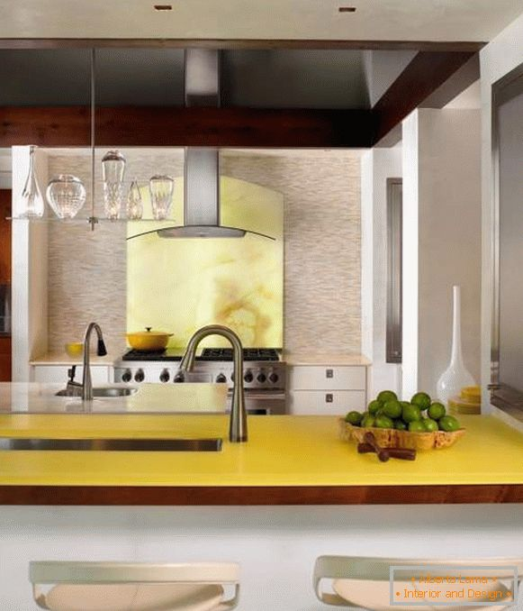 Pale yellow color in the interior of the kitchen of a private house