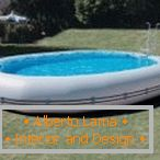 Inflatable swimming pool on site