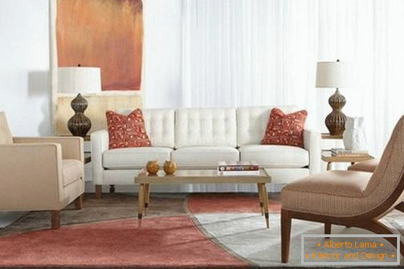 White sofa and beige armchairs in the hall