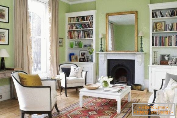 Green interior of the living room with white furniture