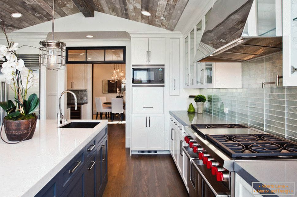 Kitchen with a gray wooden ceiling