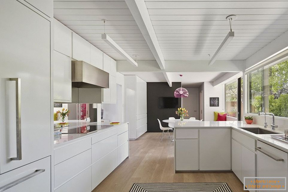 White kitchen decor with wooden ceiling
