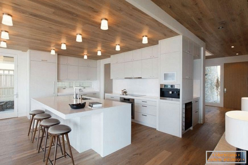 Spacious kitchen with wooden ceiling