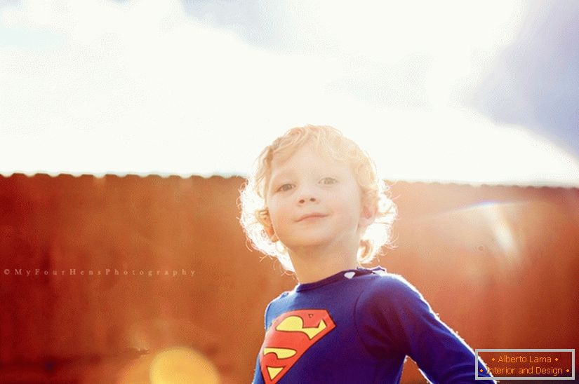 Boy in a superman costume
