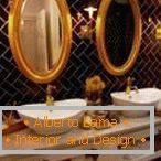 Mirrors in the bathroom with gold leaf