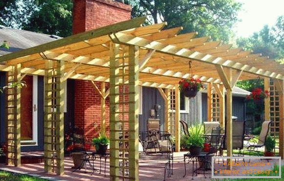 Canopy gazebo in the design of the courtyard of a private house