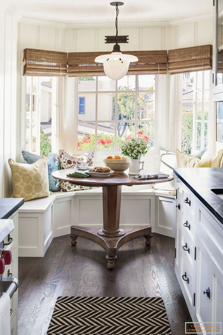 Narrow kitchen with large windows in the bay window