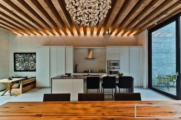 Wooden beams on the ceiling in the living room and kitchen