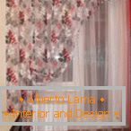 Curtain with flowers on the kitchen window