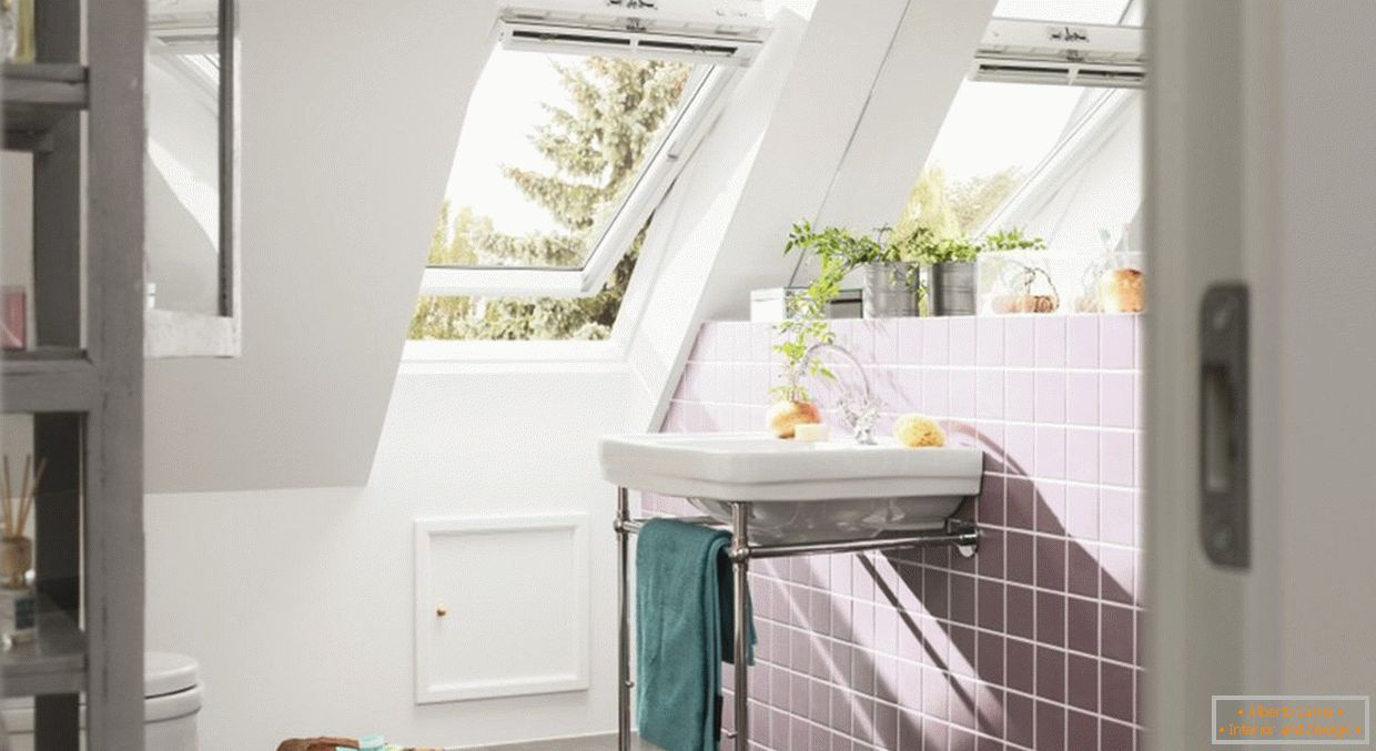 Bathroom with a window in the attic