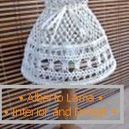 Lamp with an openwork shade