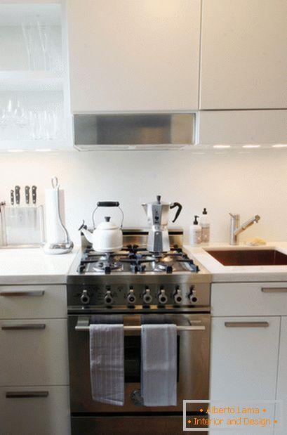 Steel gas cooker in white kitchen