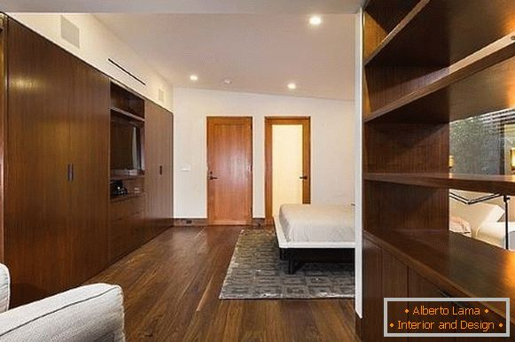 Bedroom interior with wardrobe - photo of built-in furniture