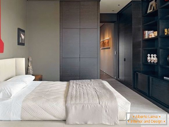 Stylish bedroom design with wardrobe with built-in furniture