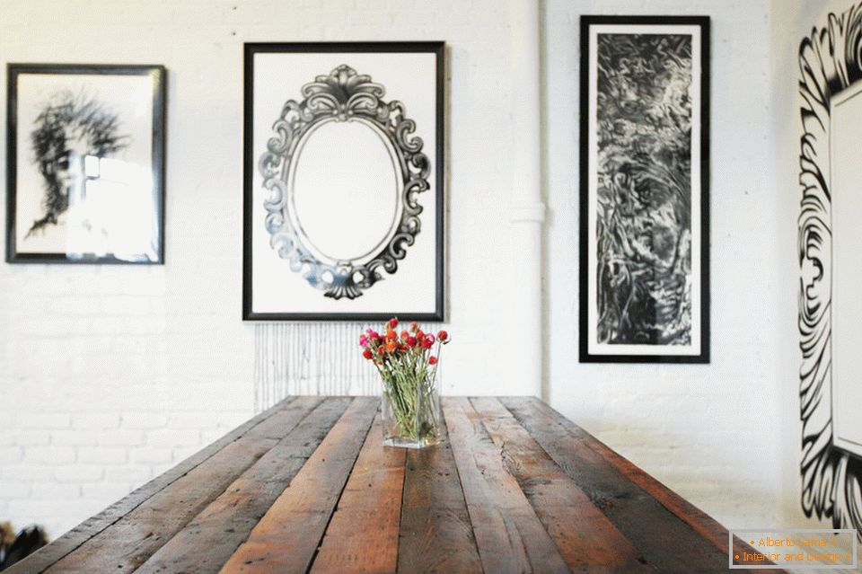 Paintings on the wall in the dining room of a stylish apartment in Brooklyn