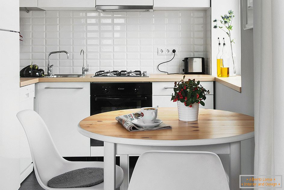 Kitchen with dining room in white color
