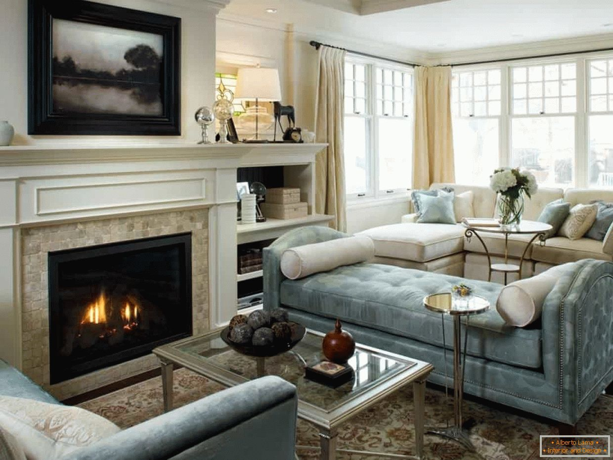 Bright design of the living room in the house with a fireplace