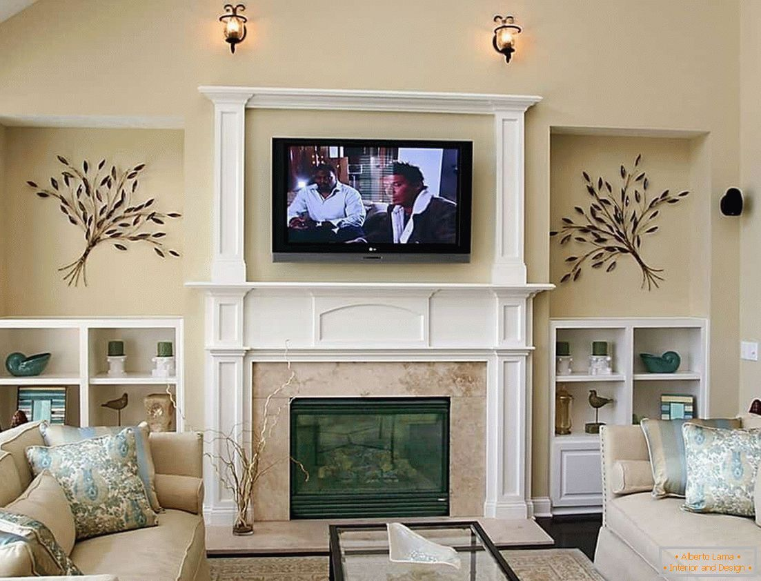 The living room with a fireplace decorated with stucco molding