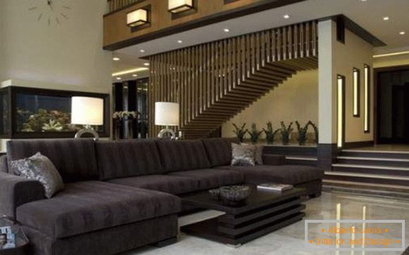 Ultramodern interior of the living room in a private house with a staircase