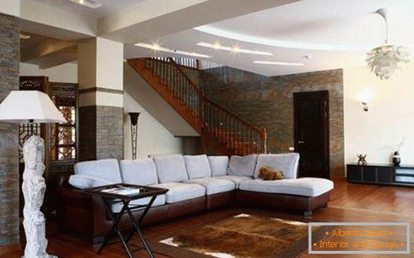 Interior of the living room with a staircase in a private house - photo of a beautiful design