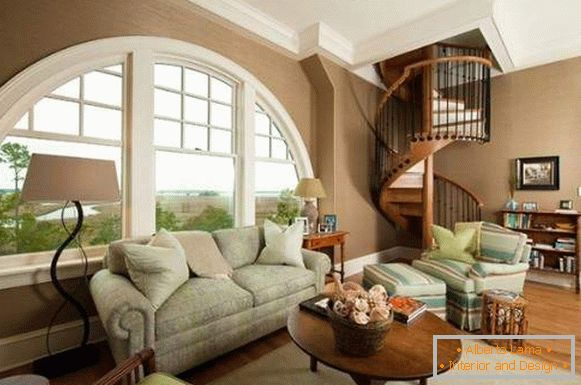 Interior of the living room with a spiral staircase in a private house - design ideas