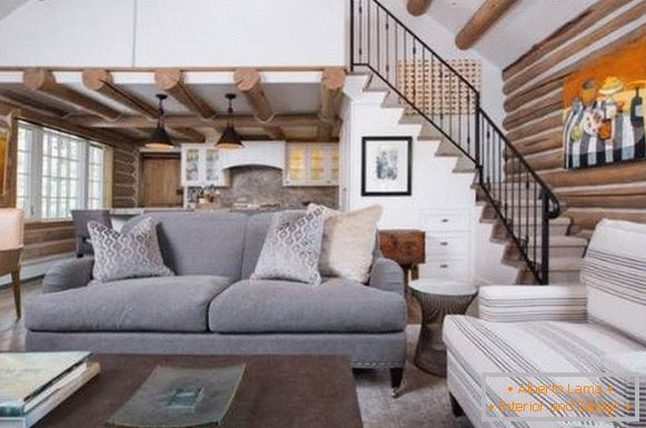 Ideas for a living room interior with a staircase in a private house - photo of 2017