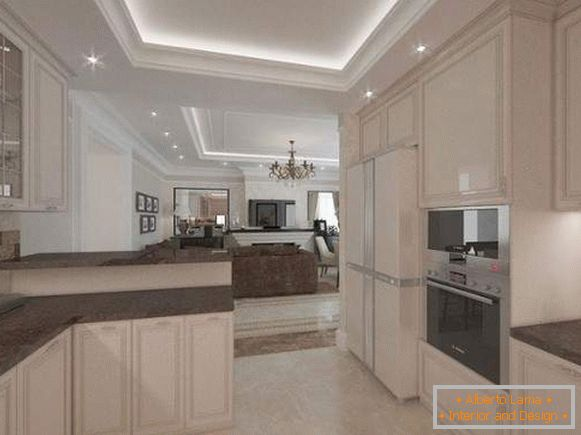 Interior of the living room kitchen in a private house in light colors with a dark top
