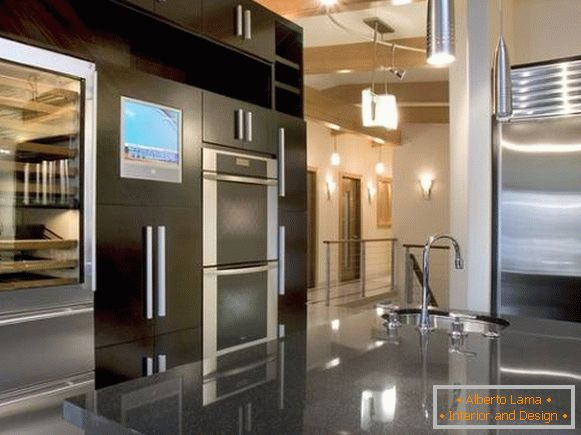 Black kitchen furniture in high-tech style