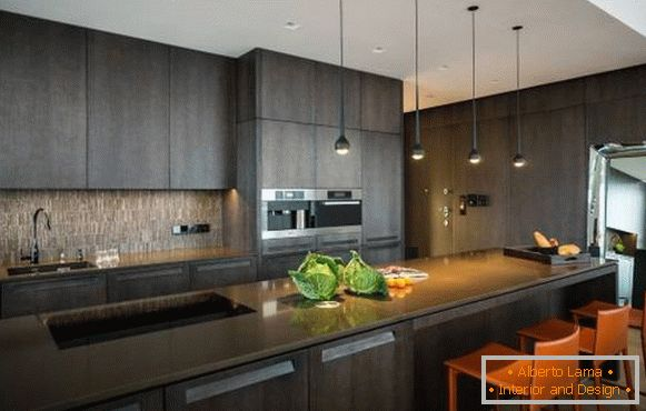 Dark gray kitchen in high-tech style on the photo