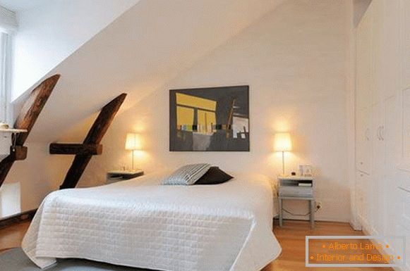 Wooden beams in the interior of a white bedroom