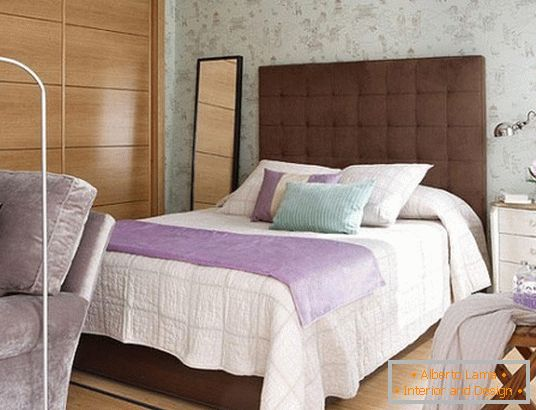 Bed with a high headboard in the bedroom