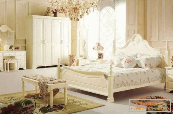 Bedroom in Provence style with crystal chandelier
