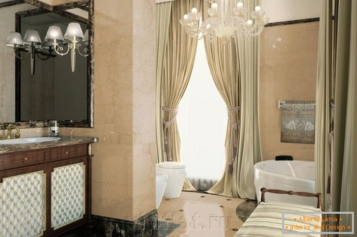 Noble decoration of the bathroom in the neoclassicism style is emphasized by properly selected furniture.