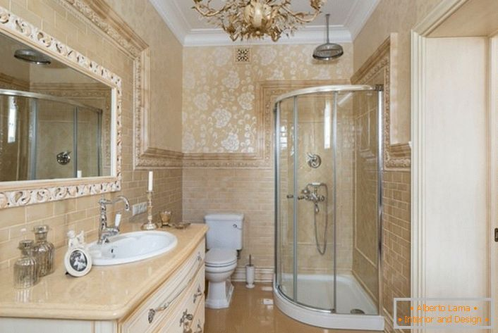 The bathroom is decorated in neoclassic style. A large mirror, framed by a wide frame, makes the picture complete.