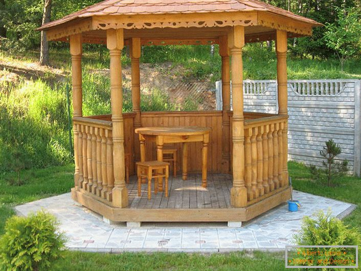 The style of the chalet can also be elegant. Functional solution - a small podium for a gazebo made of granite tiles.