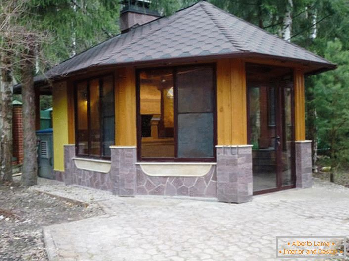 A winter gazebo in the style of a chalet is an ideal solution for designing a suburban area.