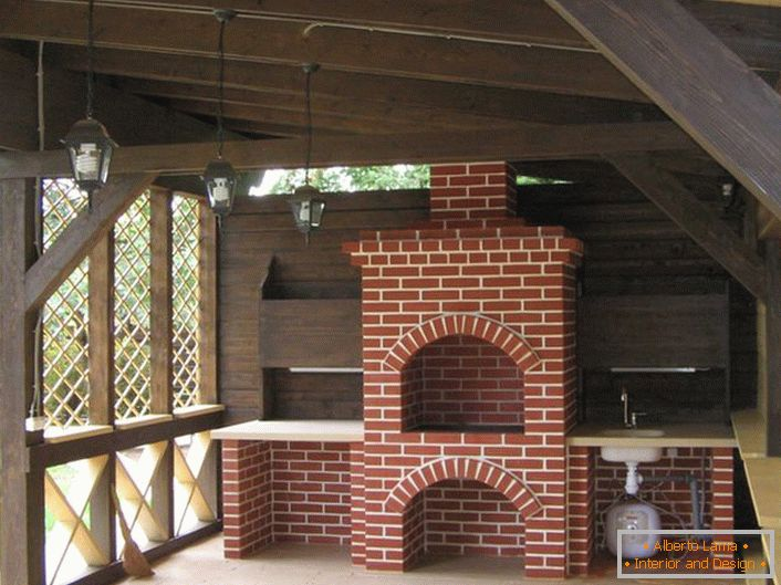 Functional decoration of the arbor in the style of the chalet was a stove-fireplace.