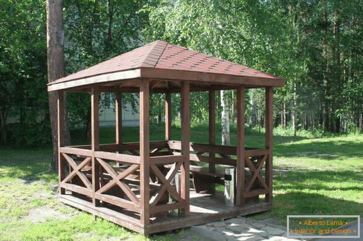 An open gazebo in the style of a chalet has an uncomplicated design that can be assembled by one's own hands.