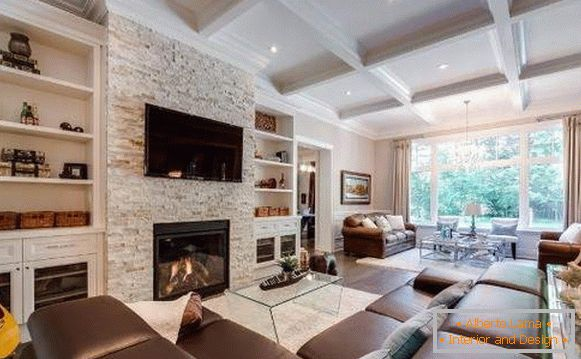 How to decorate the hall in your house - the interior of the living room with a fireplace
